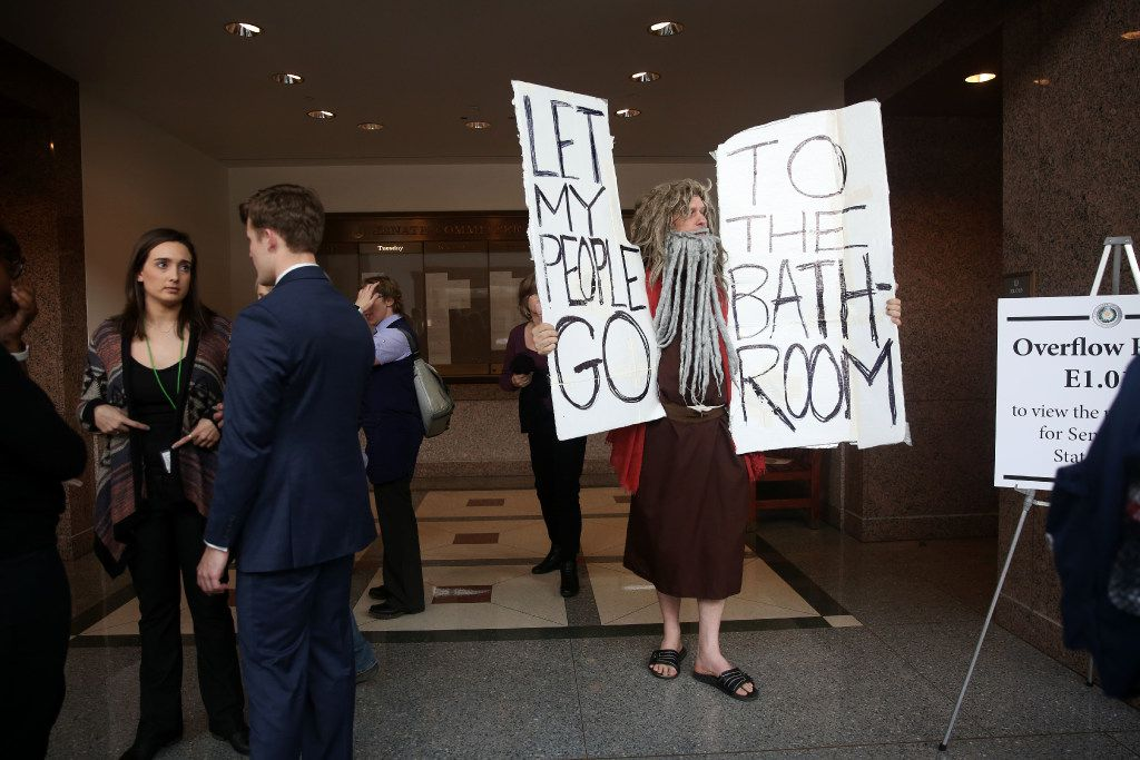 John Erler, dressed as Moses, holds signs as members of the Senate State Affairs Committee debate and hear public testimony of Senate Bill 6, the transgender bathroom bill, at the Texas State Capitol in Austin on Tuesday, March 7, 2017. The bill would bar transgender people from using the restrooms, locker and changing rooms that correspond to their gender identity in public schools and government buildings. (Rose Baca/The Dallas Morning News)