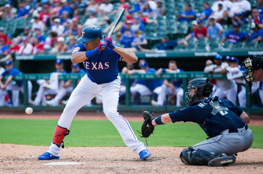 FILE - Rangers first baseman Ronald Guzman (11) bats during the eighth inning of a game against the Seattle Mariners on Sunday, Sept. 1, 2019, at Globe Life Park in Arlington.