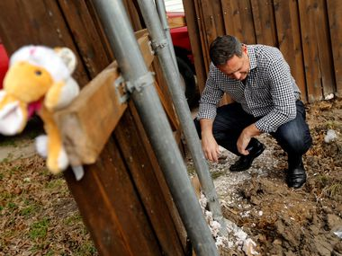 "Rep. Rafael Anchia inspects debris left behind after a demolition crew razed the remnants of the home on Espanola Drive in Dallas where 12-year-old Linda ""Michellita"" Rogers died in a natural gas explosion last year."
