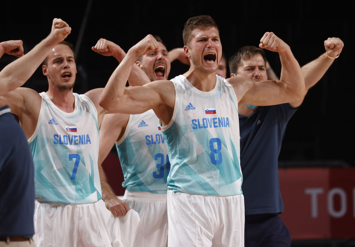 Slovenia's Edo Muric (8), Klemen Prepelic (7) and teammates celebrate after Mike Tobey (10) made a basket in play against Germany during the second half of play of a quarter final basketball game at the postponed 2020 Tokyo Olympics at Saitama Super Arena, on Tuesday, August 3, 2021, in Saitama, Japan. Slovenia defeated Germany's 94-70. (Vernon Bryant/The Dallas Morning News)