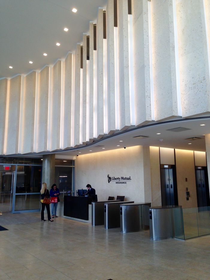 Sone panels on the wall above the ground floor reception area mimic the folds of the gown on the Statue of Liberty.