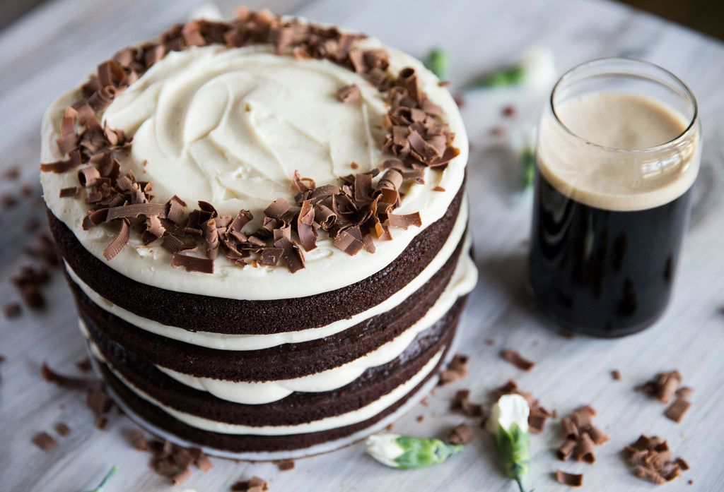 A Guinness cake with Irish cream cream cheese icing, paired with a glass of Guinness.