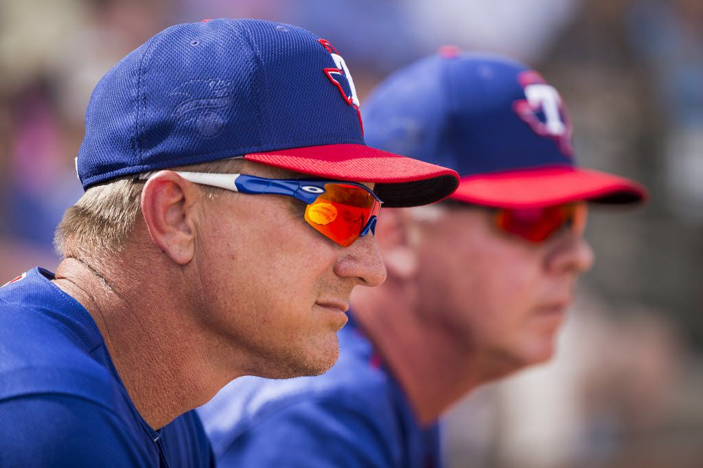 Texas Rangers manager Jeff Banister and bench coach Steve Buechele watch a spring training game against the Kansas City Royals at Surprise Stadium on Thursday, March 3, 2016, in Surprise, Ariz. (Smiley N. Pool/The Dallas Morning News)