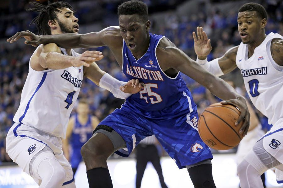 FILE - Texas-Arlington's Kevin Hervey (25) is defended by Creighton's Marcus Foster (0) and Ronnie Harrell Jr., left, during the second half of an NCAA college basketball game in Omaha, Neb., Monday, Dec. 18, 2017. (AP Photo/Nati Harnik)