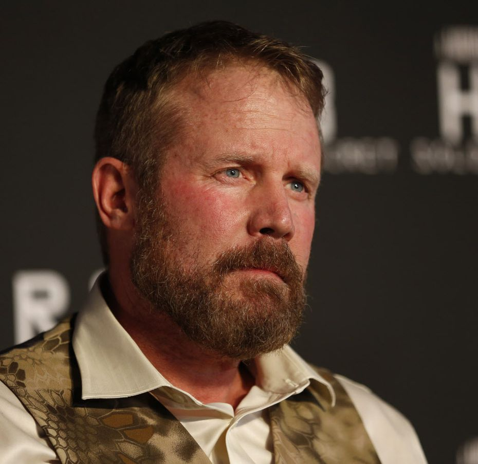 Mark Geist, who is portrayed in the movie, poses for a photograph on the red carpet at the world premiere of 13 Hours: The Secret Soldiers of Benghazi at AT&T Stadium in Arlington, Texas on Jan. 12, 2016. (Rose Baca/The Dallas Morning News)