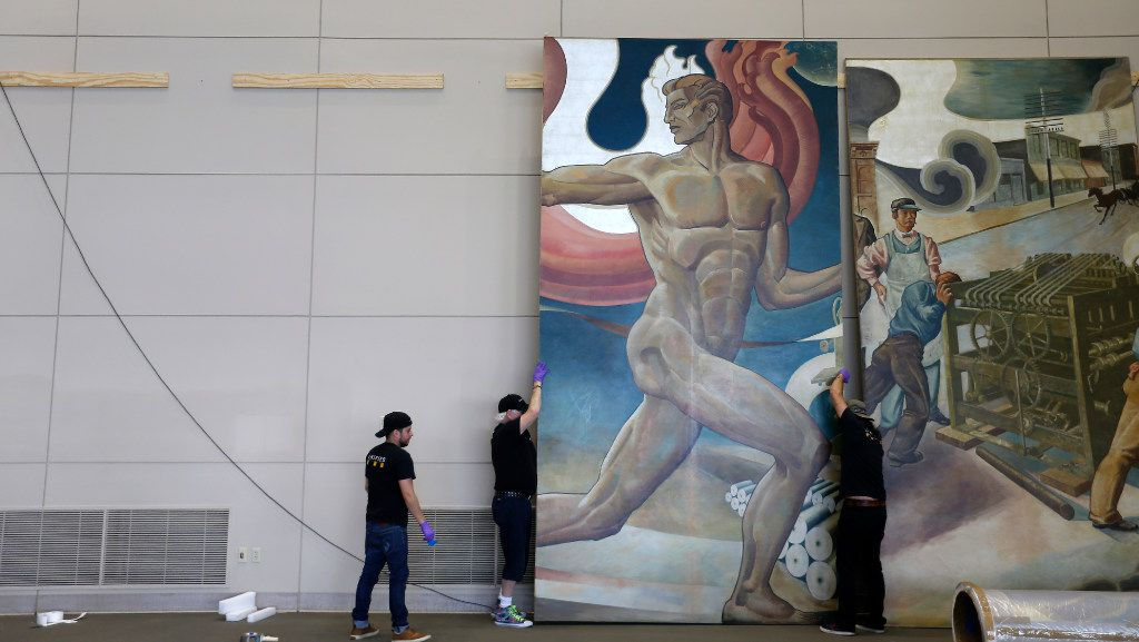 Workers from Unified Fine Arts work to remove the murals from the wall of TXCN on Tuesday, March 14, 2017, in Dallas. The murals by nine artists including Perry Nichols will be taken to the Briscoe Center for American History on the University of Texas at Austin campus. (Jae S. Lee/The Dallas Morning News)