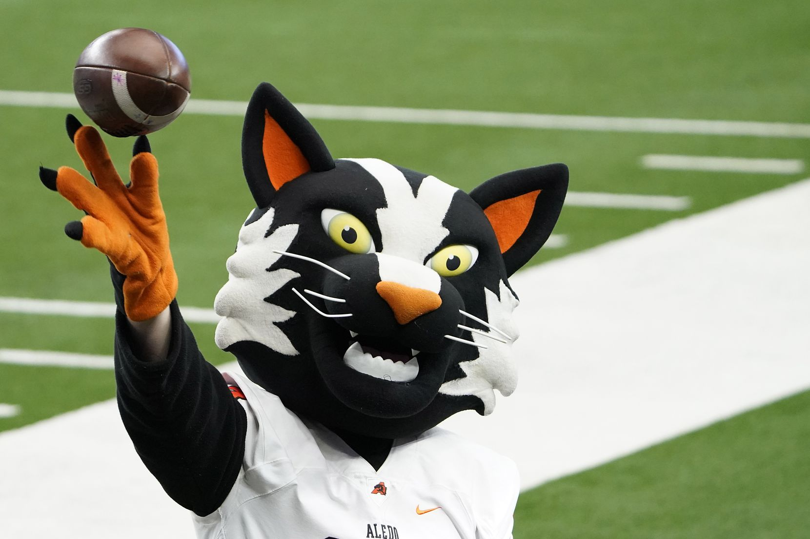 The Aledo mascot tosses a ball on the sidelines during the first half of the Class 5A Division II state football championship game against Crosby at AT&T Stadium on Friday, Jan. 15, 2021, in Arlington. (Smiley N. Pool/The Dallas Morning News)
