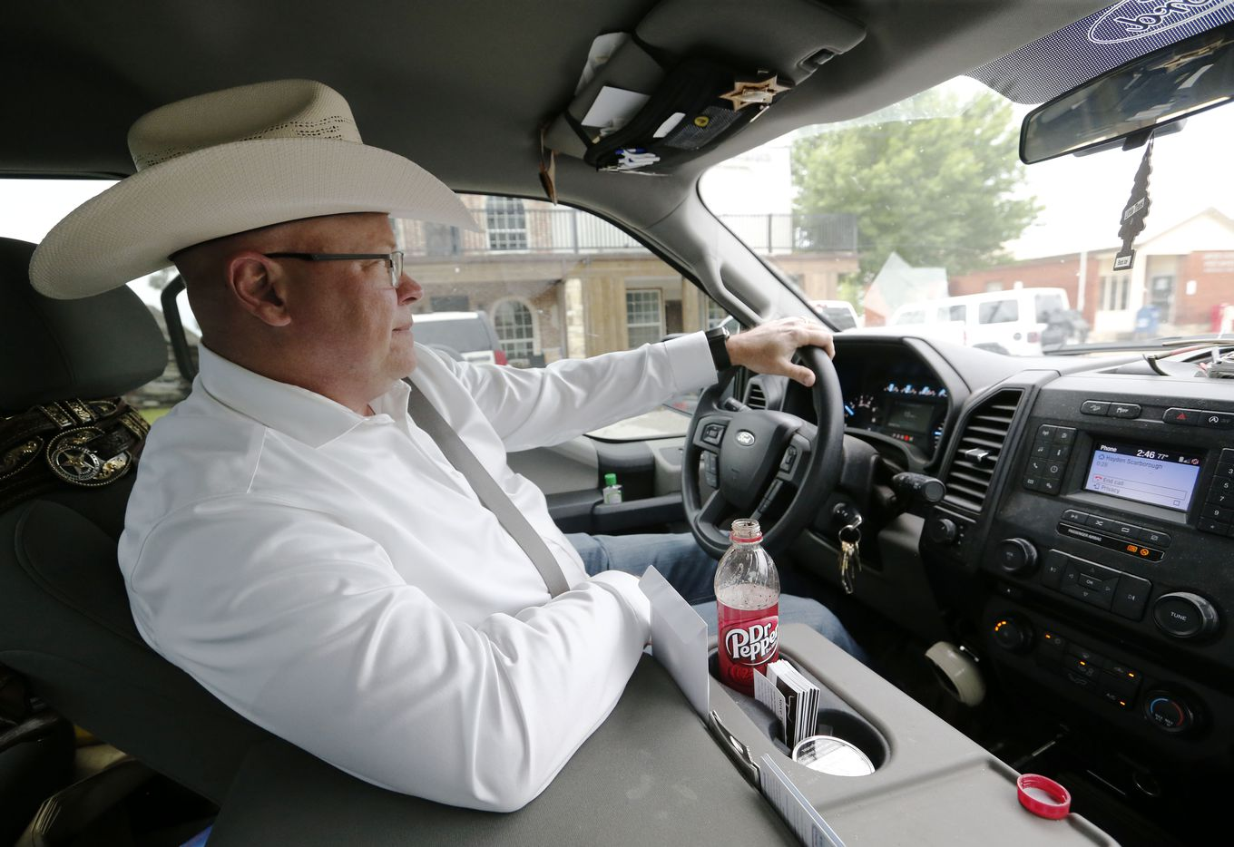 Special Ranger, John Bradshaw of the Texas and Southwestern Cattle Raisers Association talks on the phone to a rancher as he drives from Montague County Courthouse in Montague, Texas on Thursday, May 2, 2019. Bradshaw is deputized to protect ranchers from cattle rustlers.