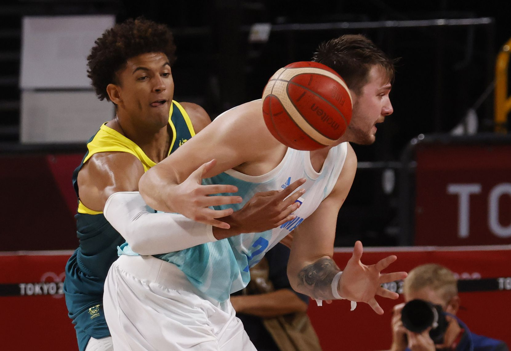 Australia's Matisse Thybulle (10) knocks the ball out of the hands of Slovenia's Luka Doncic (77) during the fourth quarter of play in the bronze medal basketball game at the postponed 2020 Tokyo Olympics at Saitama Super Arena, on Saturday, August 7, 2021, in Saitama, Japan. (Vernon Bryant/The Dallas Morning News)