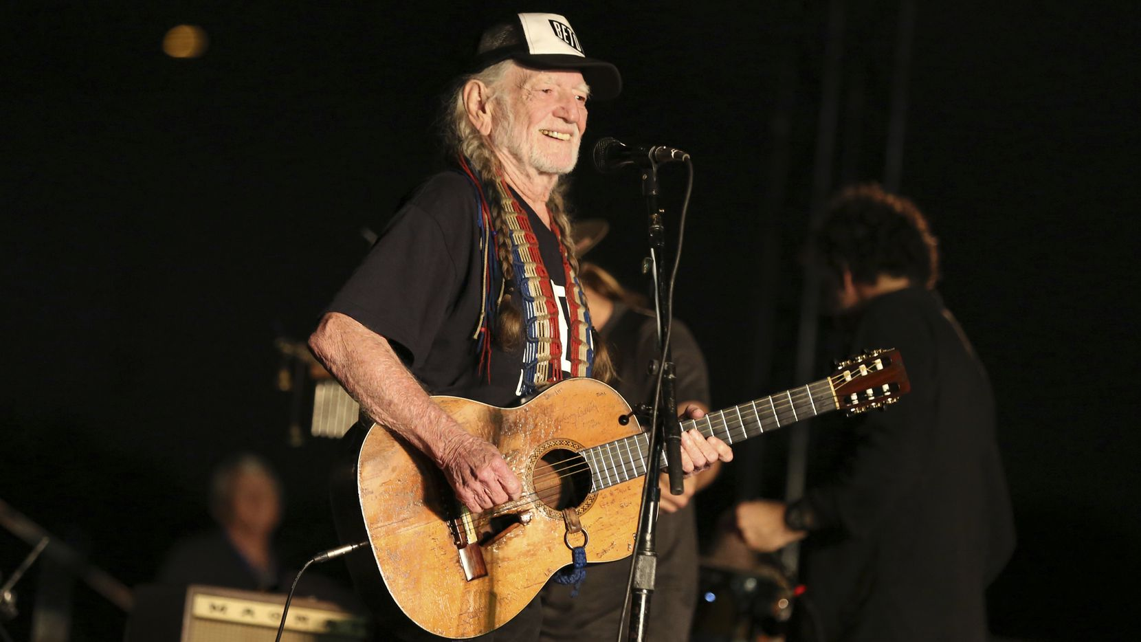 """Willie Nelson, shown performing at a Beto O'Rourke for U.S. Senate event in September 2018, is performing at Saturday's finale of the """"March for Democracy,"""" at the state Capitol in Austin. On Thursday, Nelson chided Republicans for reacting to election losses with calls for changes to voting laws, not self-examination."""
