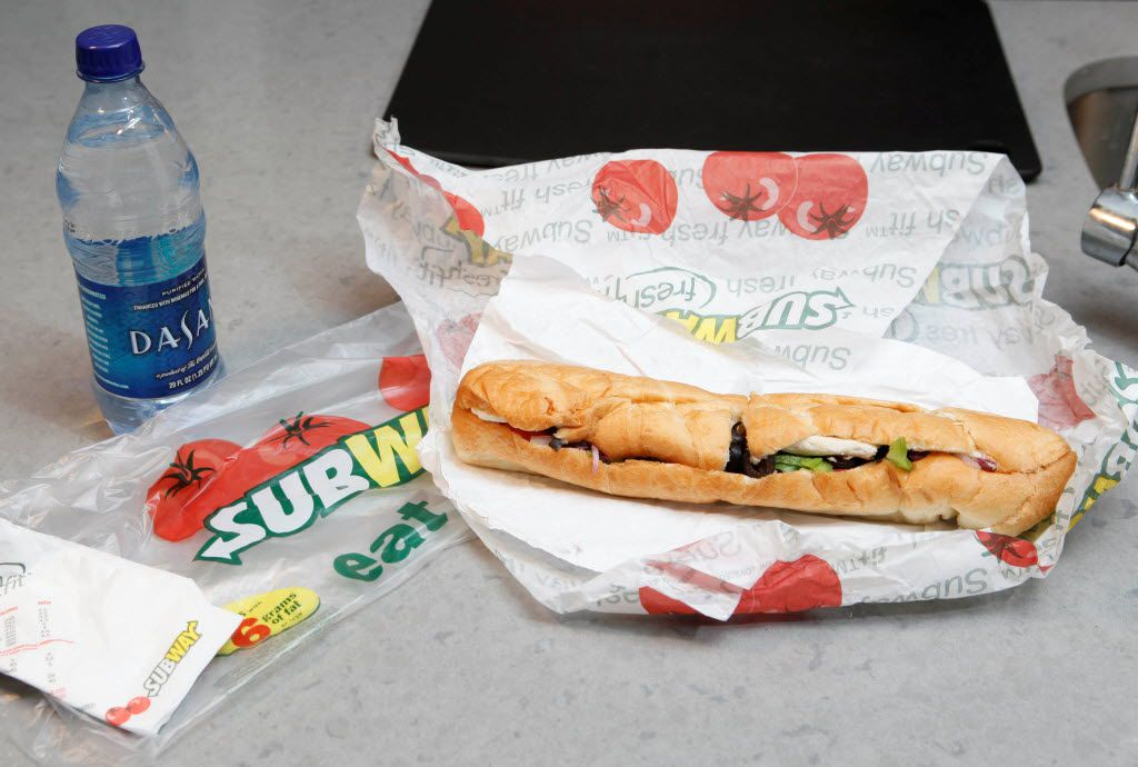 FILE - This Aug. 11, 2009, file photo, shows a chicken breast sandwich and water from subway on a kitchen counter in New York. Subway, the world's largest fast food chain, is facing criticism after an Australian man posted a picture on the company's Facebook page on Jan. 16, 2013, of one of its famous sandwiches next to a tape measure that seems to shows it's not as long as promised.  (AP Photo/Seth Wenig, File) 01182013xBIZ