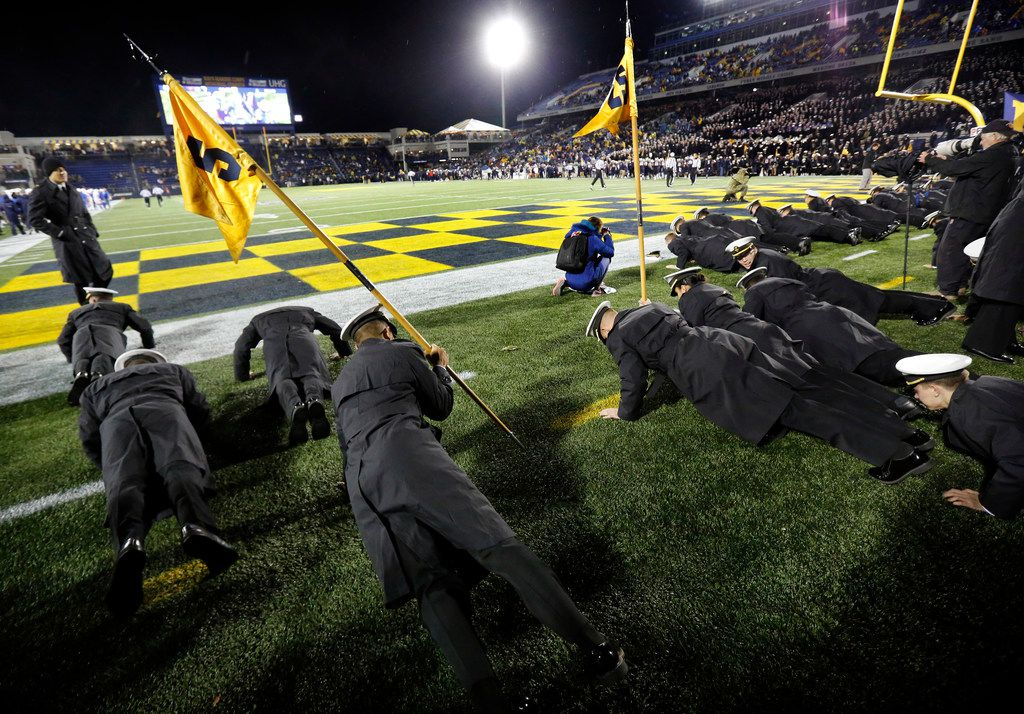 The Navy Midshipmen do pushups in the ned zone after a fourth quarter touchdown against the Southern Methodist Mustangs at Navy-Marine Corps Memorial Stadium in Annapolis, Maryland, Saturday, November 23, 2019. (Tom Fox/The Dallas Morning News)