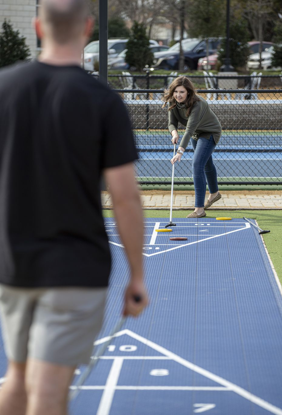 Kyle and Kaitlyn Tatum play a game of shuffleboard outside Standard Service in Heath.