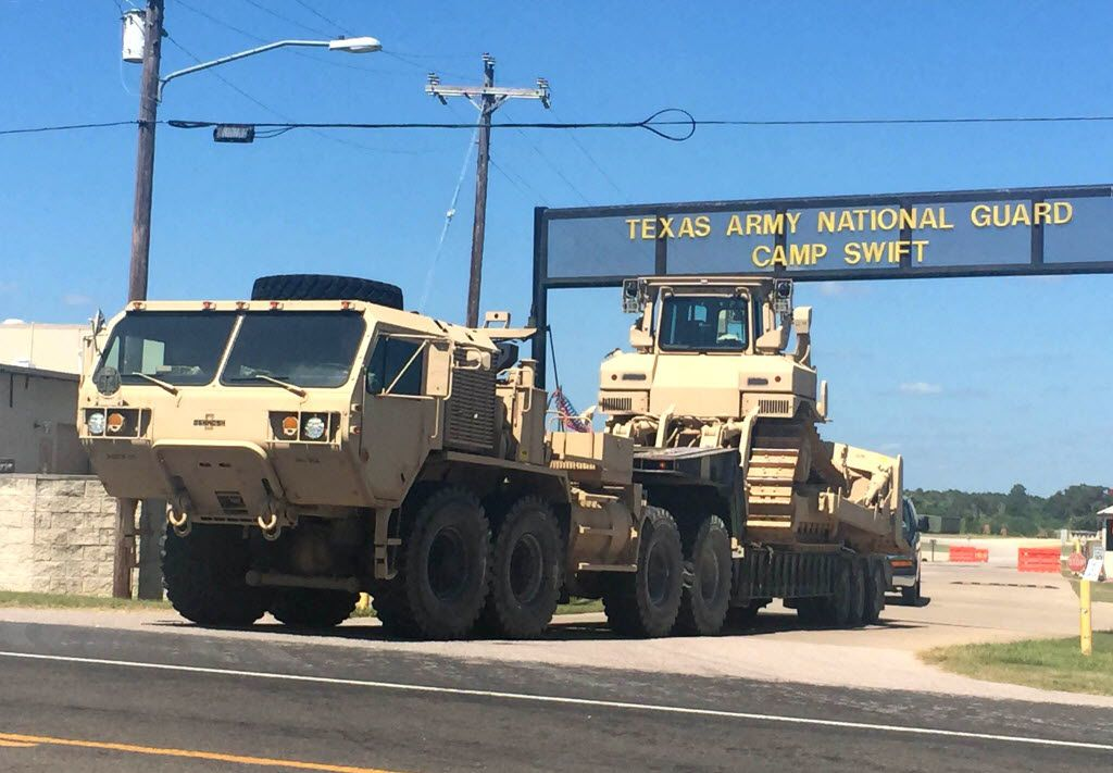 Heavy equipment rolls out of one of the gates to Texas Army Nation Guard Camp Swift outside of Bastrop, Texas, on July 15, 2015. Jade Helm 15 began today after months of internet-fed hysteria about the military exercises.