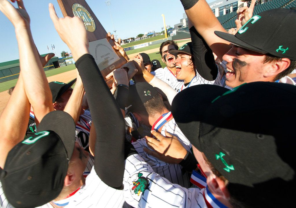 Euphoria filled the air as Southlake Carroll players hoisted the Class 6A championship trophy after defeating Fort Bend Ridge Point by the score of 17-0. The two teams played in the Class 6A state championship baseball game at Dell Diamond in Round Rock on June 8, 2019. (Steve Hamm/ Special Contributor)