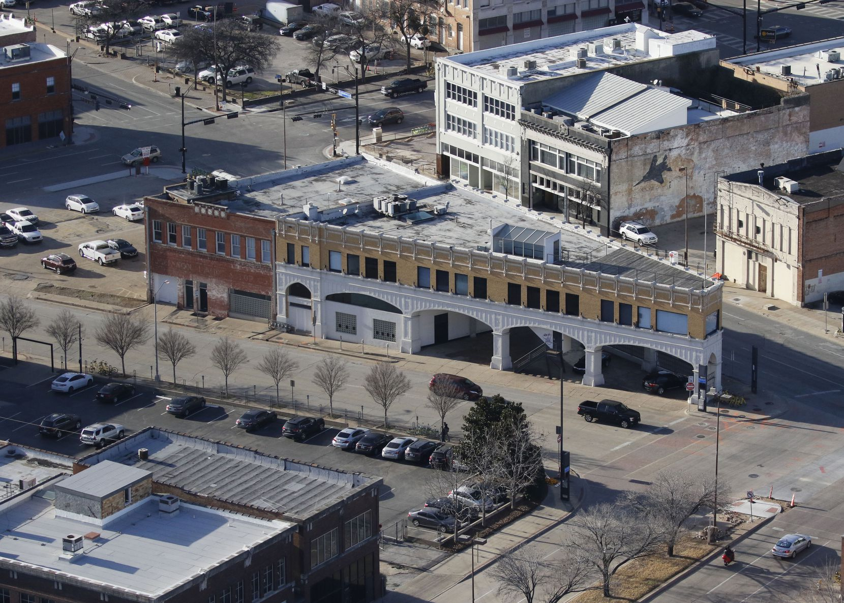 Todd Interests has completed its purchase of almost two dozen old buildings on downtown Dallas' east side.