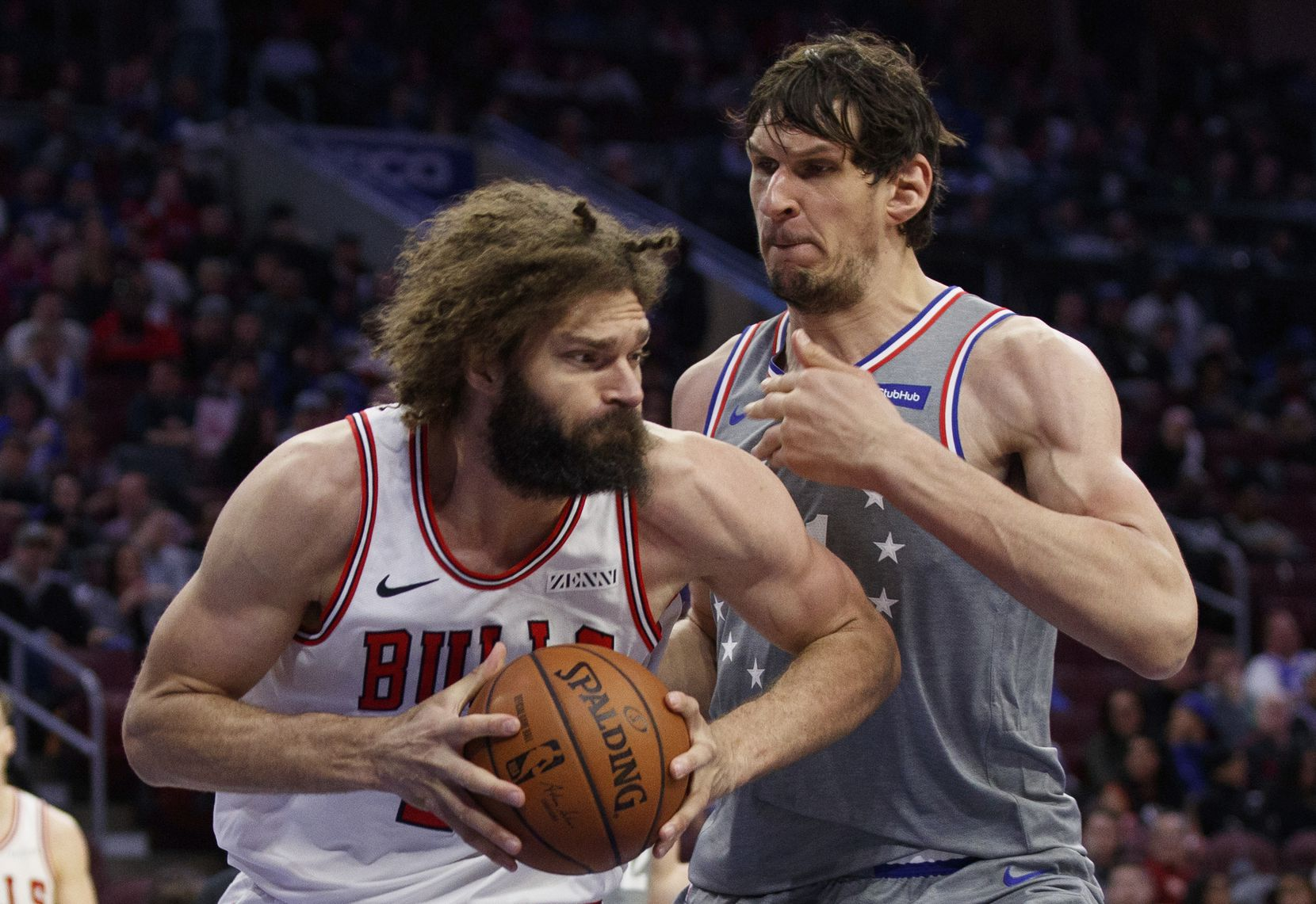 FILE - Chicago Bulls' Robin Lopez, left, makes his move against Philadelphia 76ers' Boban Marjanovic, right, of Serbia, during the second half of an NBA basketball game, Wednesday, April 10, 2019, in Philadelphia. 76ers won 125-109. (AP Photo/Chris Szagola)