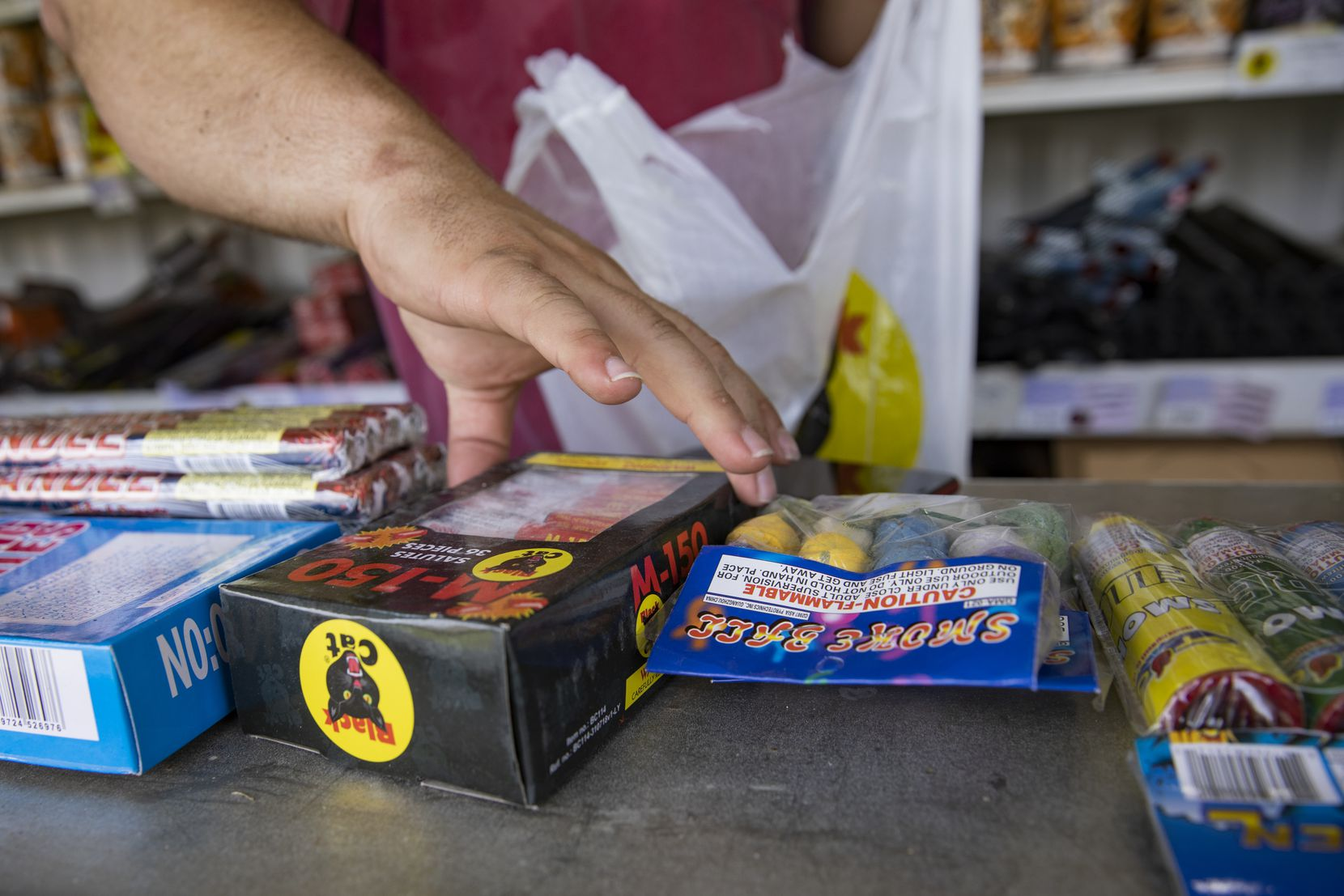 Brock Rodgers bagged up some pyrotechnics for a customer at Eagle Fireworks in Midlothian on Thursday.