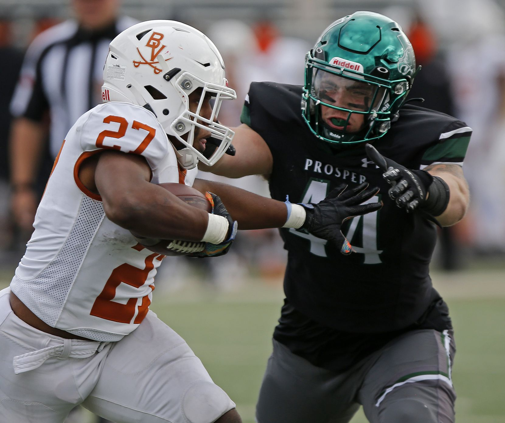 Arlington Bowie High School running back Kameron Sanders (27) tires to stiff arm Prosper High School middle linebacker Aidan Siano (44) during the second half as Prosper High School played Arlington Bowie High School in a Class 6A Division II area-round playoff game at Mustang-Panther Stadium in Grapevine on Saturday, December 19, 2020.  (Stewart F. House/Special Contributor)
