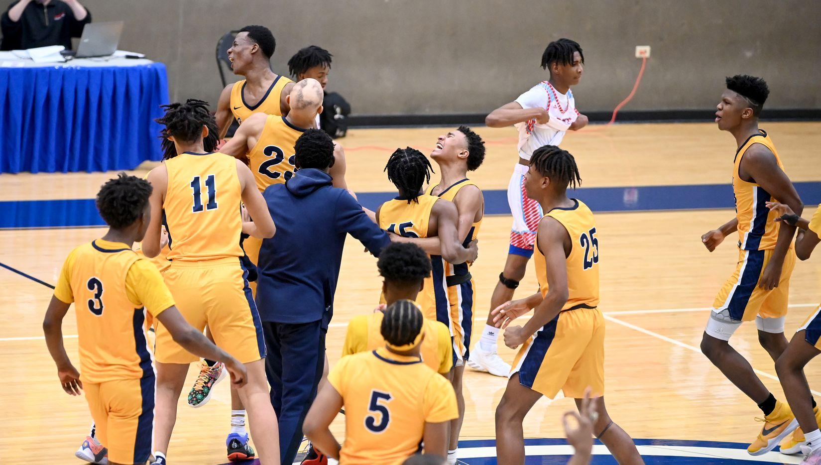 Faith Family team members celebrate their win of a Class 4A Region II final boys playoff basketball game between Dallas Carter and Oak Cliff Faith Family, Friday, March 5, 2021, in Grand Prairie, Texas. (Matt Strasen/Special Contributor)