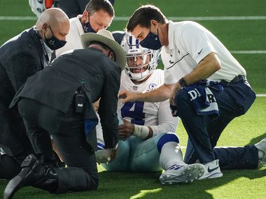 Dallas Cowboys quarterback Dak Prescott receives medical attention after being injured on a tackle by New York Giants cornerback Logan Ryan during the third quarter of an NFL football game at AT&T Stadium on Sunday, Oct. 11, 2020, in Arlington. Prescott was injured o the play when Ryan came down on his right leg and left the game.