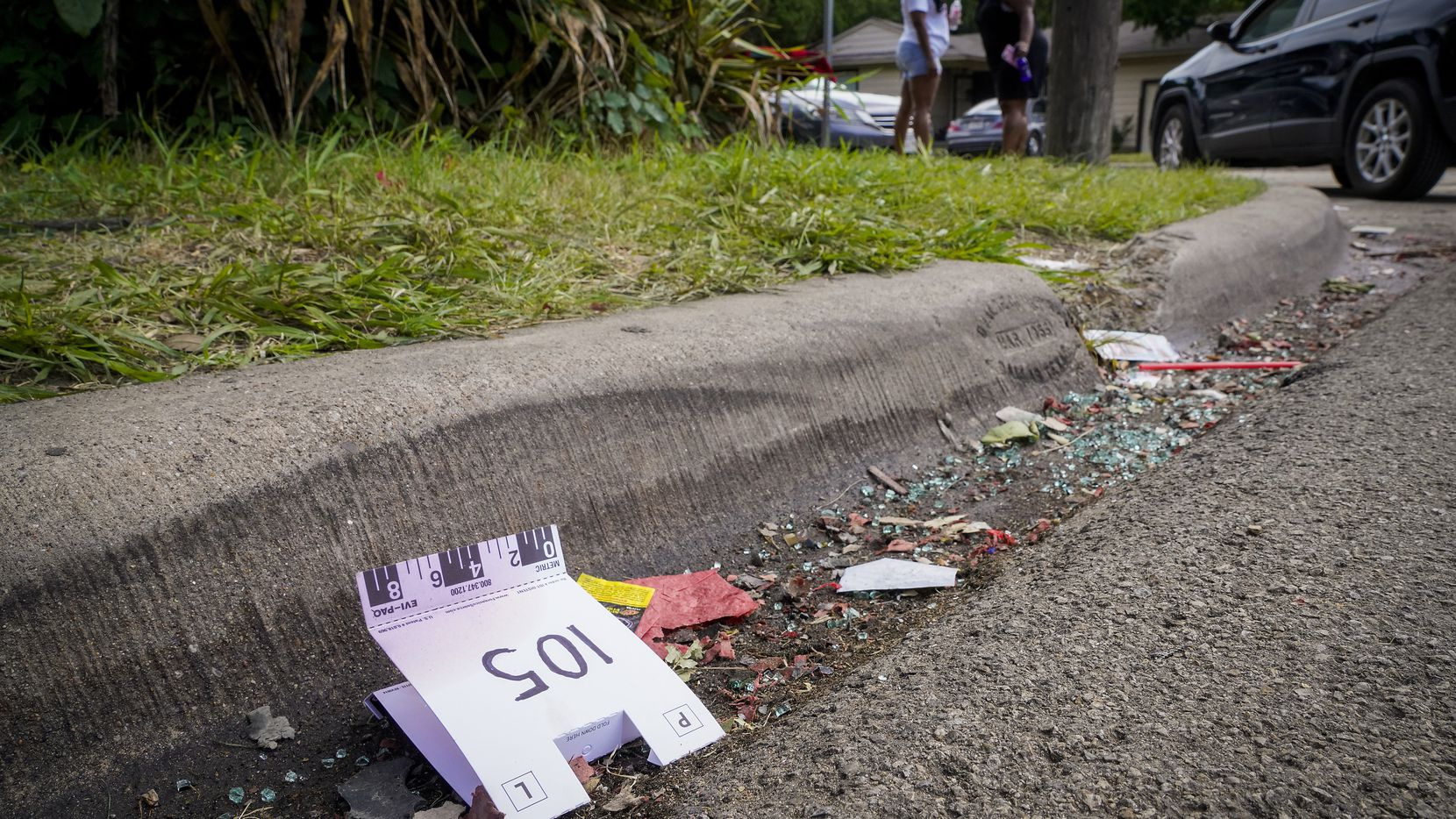 A crime scene evidence tent rests in the gutter near the scene of a shooting in the 8300 block of Towns Street in Hamilton Park on Monday, July 5, 2021, in Dallas. Five people were shot as a party wound down about 11:15 p.m. Sunday the 4th. Three of those have died. (Smiley N. Pool/The Dallas Morning News)