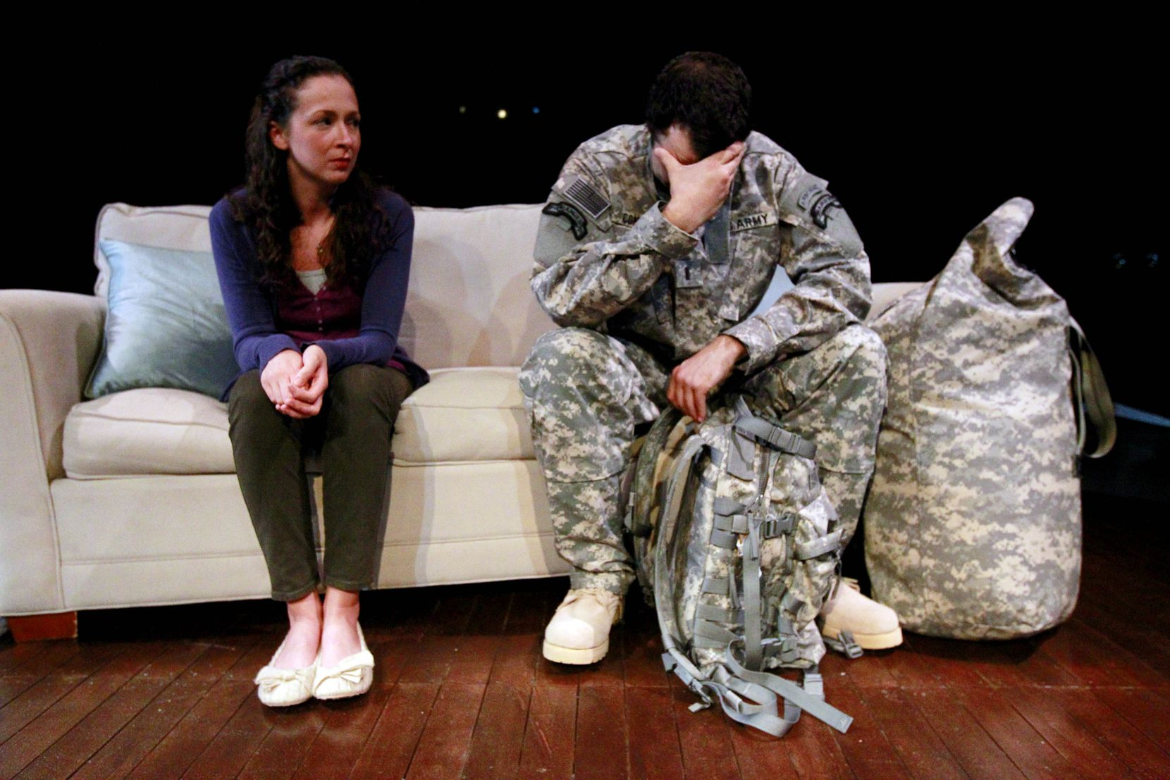 "Grace Heid, who portrays Kelly, and Rhett Henckel, who portrays twin brothers Peter and Craig, rehearsed a scene in ""Dying City"" at WaterTower Theatre in Addison in June 2011.  (File Photo/The Dallas Morning News)"