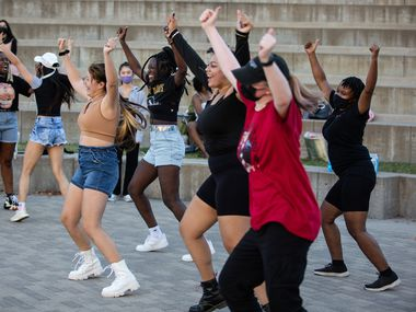 K-pop fans dance during a random dance play at a meetup organized by AEON, a Texas-based K-pop cover dance team, at Vitruvian Park in Addison earlier this month.  (Shelby Tauber/Special Contributor)