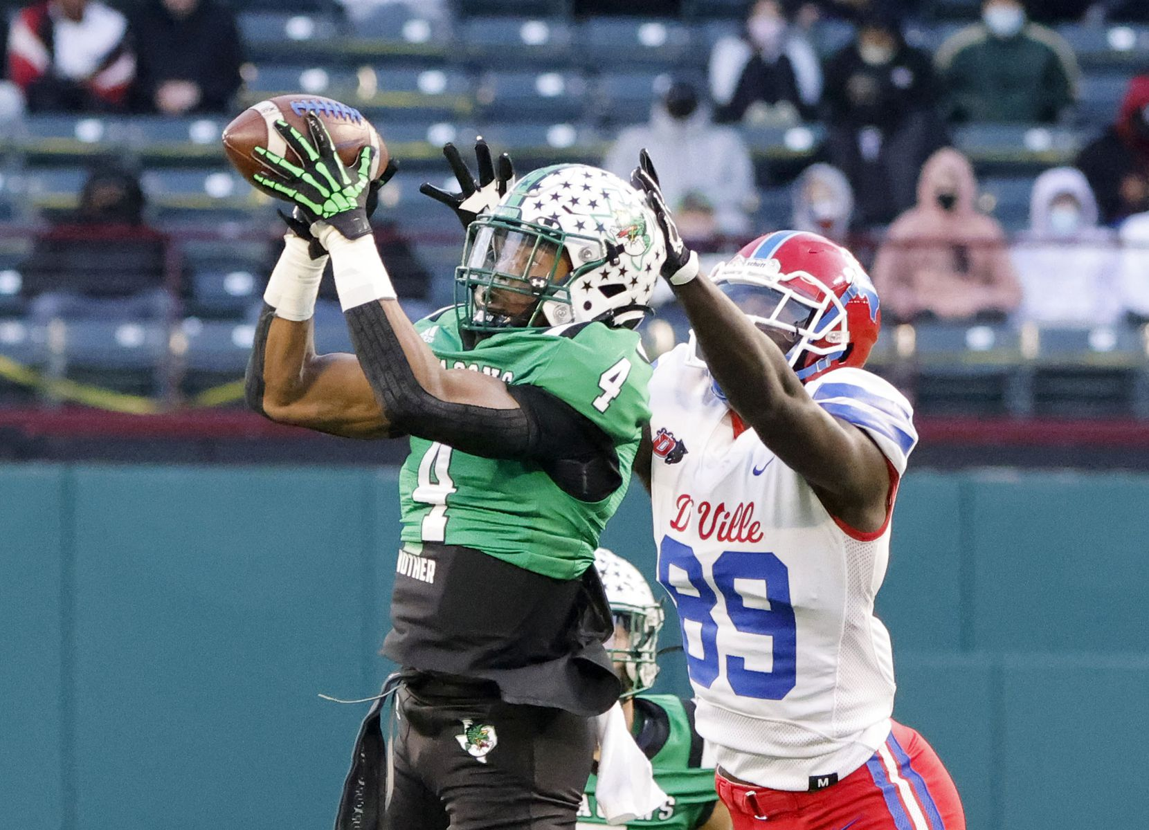 Southlake defender Cinque Williams (4) makes an interception on a pass intended for Duncanville's Jerrale Powers (89) during the Class 6A Division I state high school football semifinal in Arlington, Texas on Jan. 9, 2020. (Michael Ainsworth)