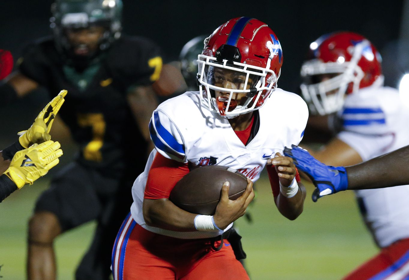 Duncanville senior quarterback Solomon James carries the ball during the second half of a high school football game against DeSoto at DeSoto High School, Friday, September 17, 2021. Duncanville won 42-21. (Brandon Wade/Special Contributor)