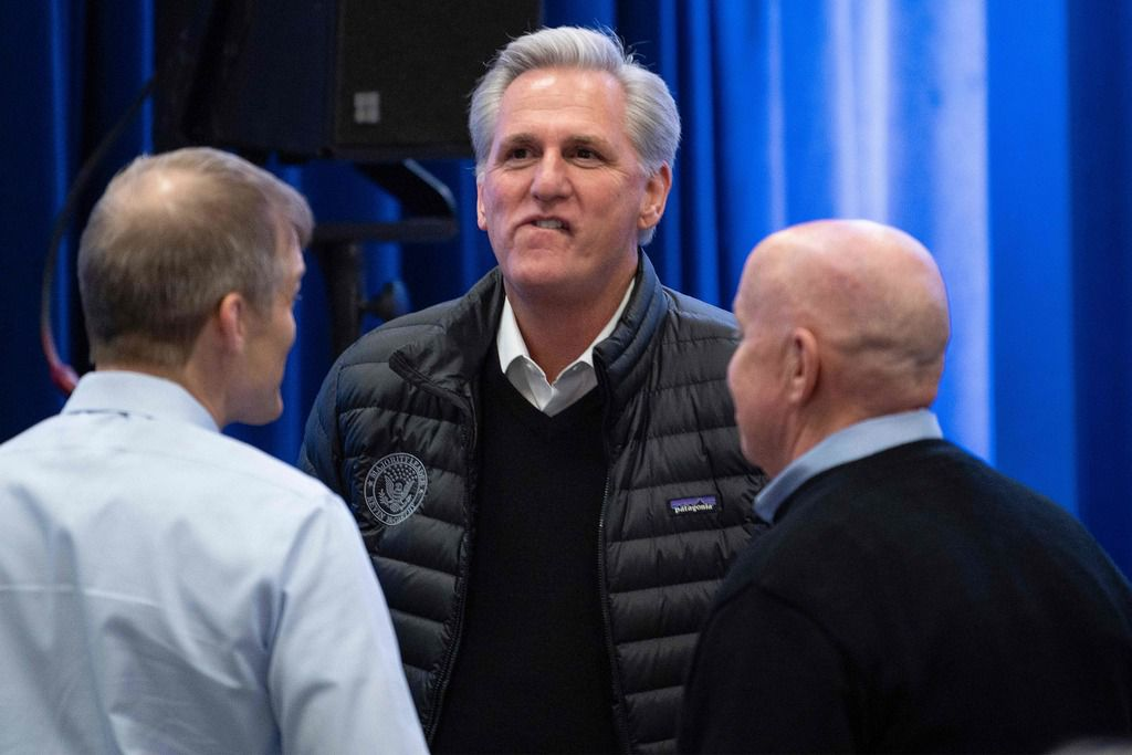 House Minority Leader Kevin McCarthy speaks with Reps. Jim Jordan of Ohio (left) and Kevin Brady of Texas in Des Moines on February 3, 2020.