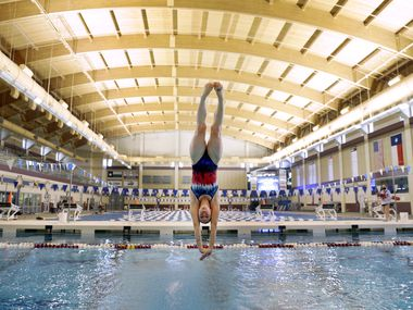 Laura Wilkinson, who won an Olympic gold medal in 2000, practices a series of dives at the Conroe Independent School District Natatorium. The 43-year-old diver is attempting an Olympic comeback after recovering from spinal surgery.