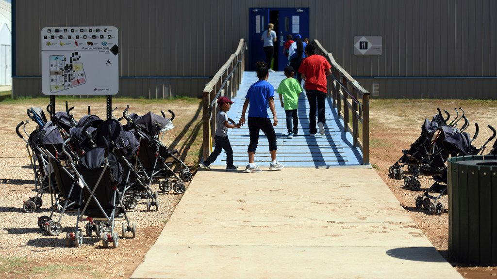 In this Aug. 9, 2018, file photo, provided by U.S. Immigration and Customs Enforcement, immigrants walk into a building at South Texas Family Residential Center in Dilley, Texas.