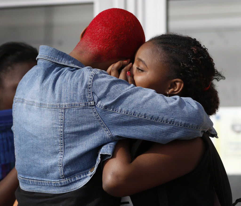 Twanna Washington (left) comforts her daughter Terrianna Washington, 13, a sixth grader, as she gets out of class at Prime Prep Academy for the last time in Fort Worth. (Rose Baca/The Dallas Morning News)