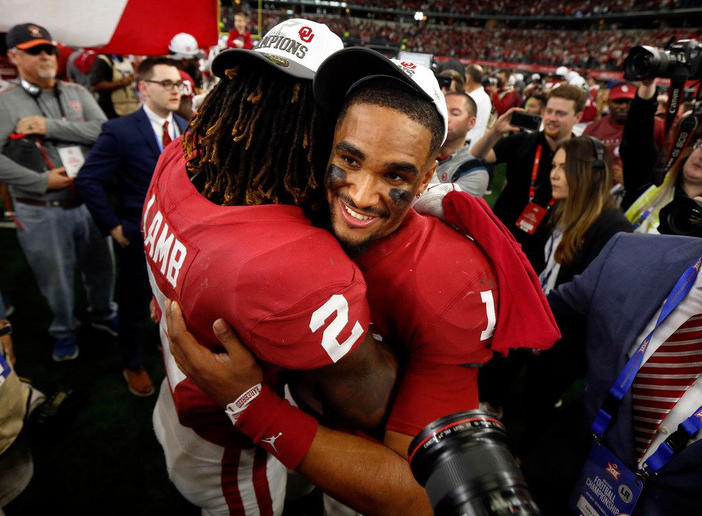 Oklahoma Sooners quarterback Jalen Hurts (1) and wide receiver CeeDee Lamb (2) celebrate their win over the Baylor Bears in the Big 12 Championship at AT&T Stadium in Arlington, Saturday, December 7, 2019. Oklahoma won in overtime, 30-23. (Tom Fox/The Dallas Morning News)