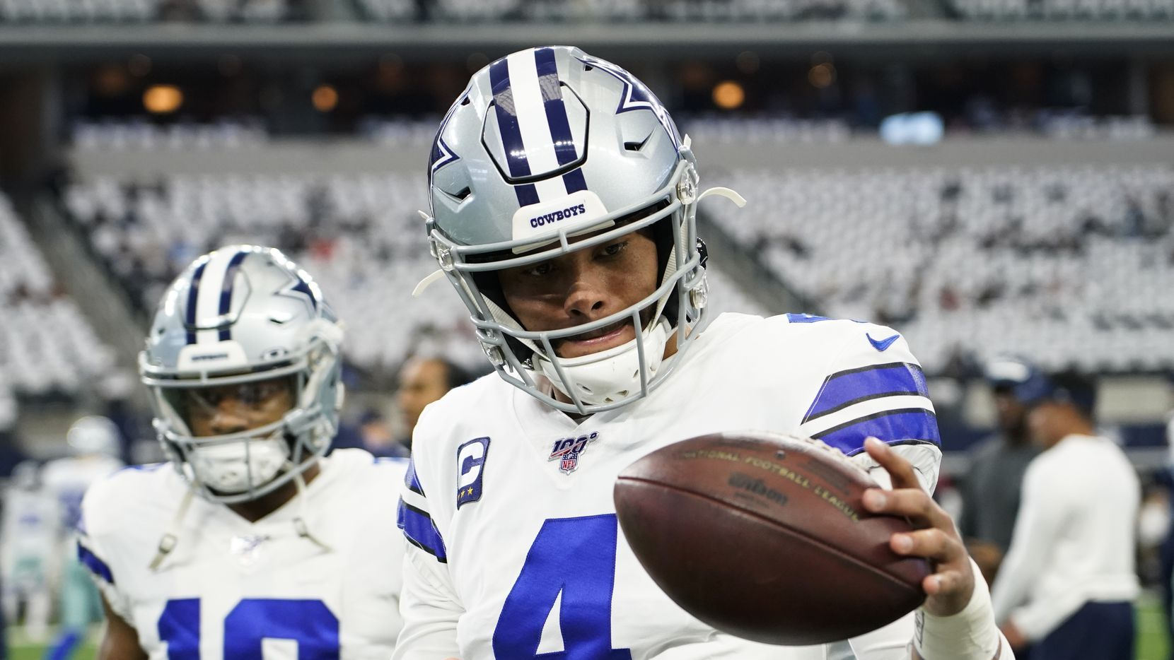 Dallas Cowboys quarterback Dak Prescott warms up before an NFL football game against the Washington Redskins at AT&T Stadium on Sunday, Dec. 29, 2019, in Arlington.