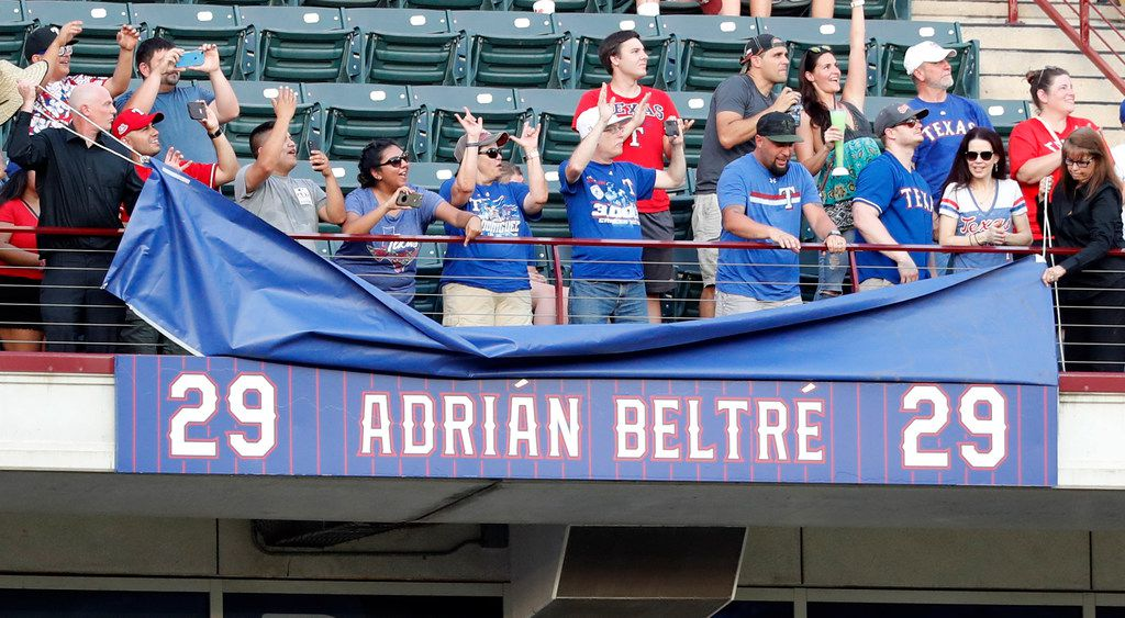 A plaque in left field is unveiled to commemorate former player Adrian Beltre's jersey retirement before the second baseball game of a doubleheader against the Oakland Athletics in Arlington, Texas, Saturday, June 8, 2019. (AP Photo/Tony Gutierrez)