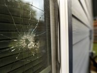 A bullet hole from the police officer's shot is seen in the rear window of Atatiana Jefferson's home on E. Allen Ave in Fort Worth, Tuesday, October 15, 2019 after former Fort Worth police officer Aaron Dean shot into the home and killed Atatiana Jefferson. (Tom Fox/The Dallas Morning News)