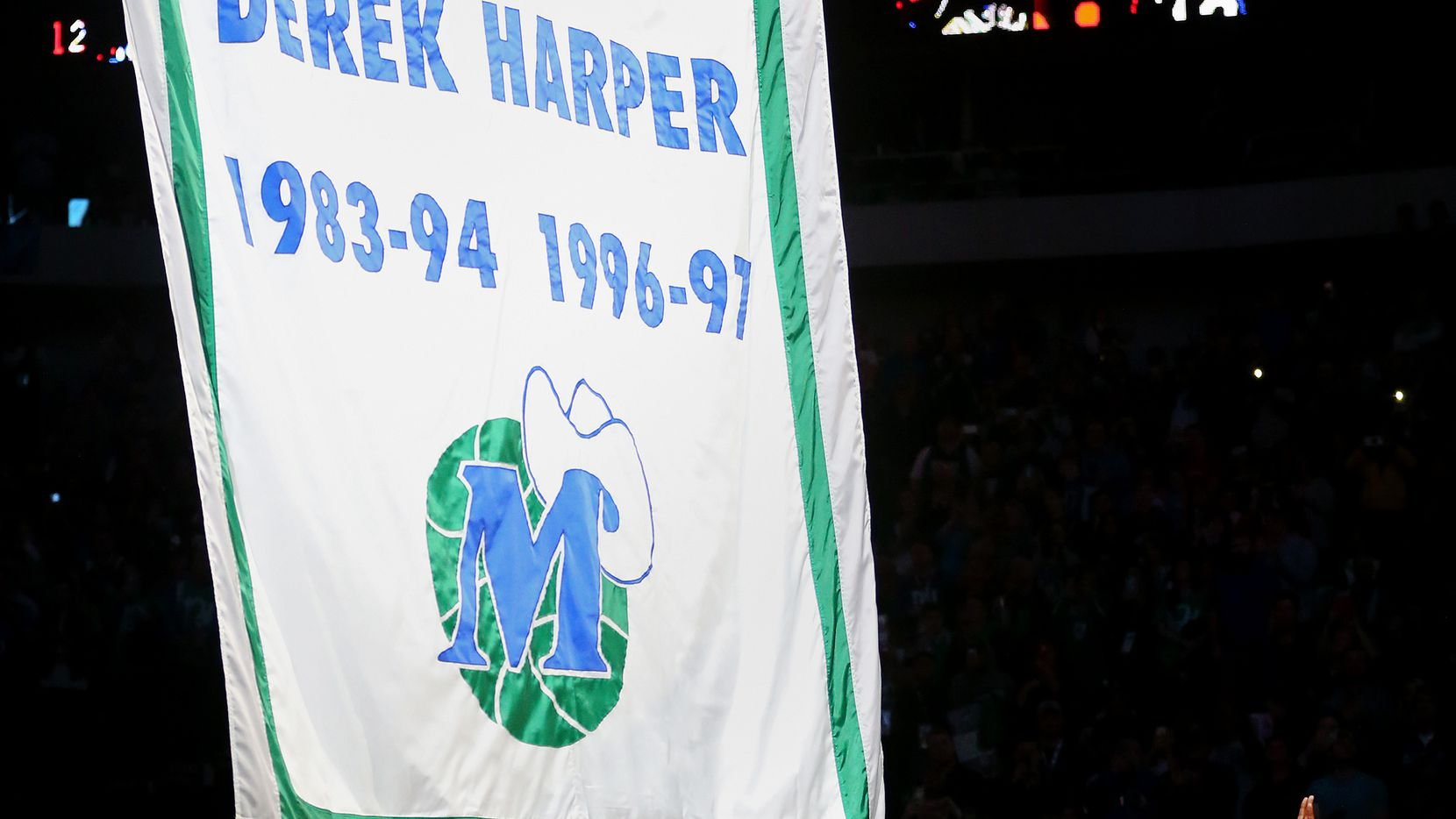 Former Dallas Mavericks player Derek Harper reacts after the unveils of his retired number 12 jersey during halftime of a National Basketball League game between the New York Knicks and Dallas Mavericks at the American Airlines Center in Dallas Sunday January 7, 2018. (Andy Jacobsohn/The Dallas Morning News)