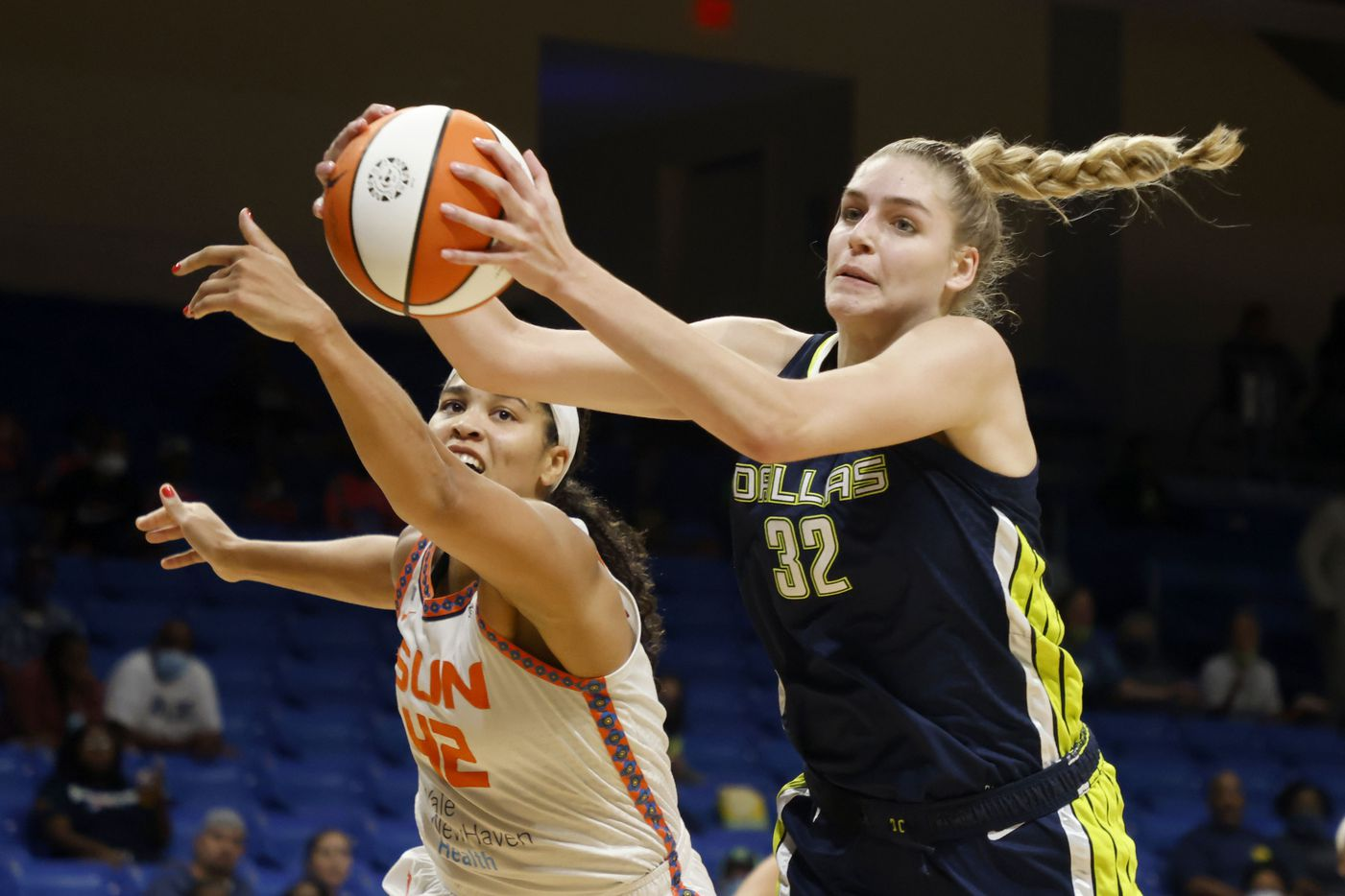 Dallas Wings center/forward Bella Alarie (32) grabs a rebound in front of Connecticut Sun forward Brionna Jones (42) during the first half of a WNBA basketball game in Arlington, Texas on Tuesday, Sept. 07, 2021. (Michael Ainsworth/Special Contributor)
