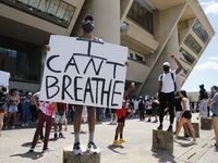 Protesters rally during a demonstration against police brutality in downtown Dallas, on Saturday, May 30, 2020. George Floyd died in police custody in Minneapolis on May 25. Minneapolis police officer Derek Chauvin, who had his knee on the neck of Floyd for at least five minutes has been charged with murder and manslaughter earlier today.