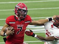 Cedar Hill quarterback Kaidon Salter (7) pushes away from Katy defensive back Bobby Taylor (3) during the first half of the Class 6A Division II state football championship  game at AT&T Stadium on Saturday, Jan. 16, 2021, in Arlington, Texas.