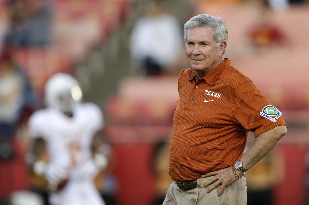 """FILE - ZThis is an Oct. 3, 2013 file photo showing University of Texas football head coach Mack Brown watching his team warm up before an NCAA college football game against Iowa State, in Ames, Iowa. Former Texas coach Brown will serve as a studio analyst for college football games on ABC. Brown stepped down in December after 16 years with the Longhorns, winning the national title after the 2005 season. Brown will appear on """"College Football Countdown"""" and offer pregame, halftime and postgame commentary for the games on ABC, including """"Saturday Night Football."""" (AP Photo/Charlie Neibergall, File) / mug - mugshot - headshot - portrait / 08262014xSPORTS 10242014xBRIEFING"""