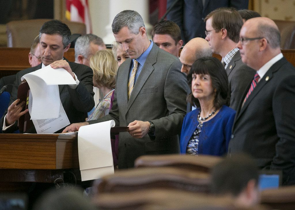 Southlake GOP Rep. Giovanni Capriglione, left, flips through pages of his bill as he answers questions from fellow members. He is the author of HB 2962, an abortion bill brought up for second reading during session Thursday afternoon, hours before a bill passing deadline.
