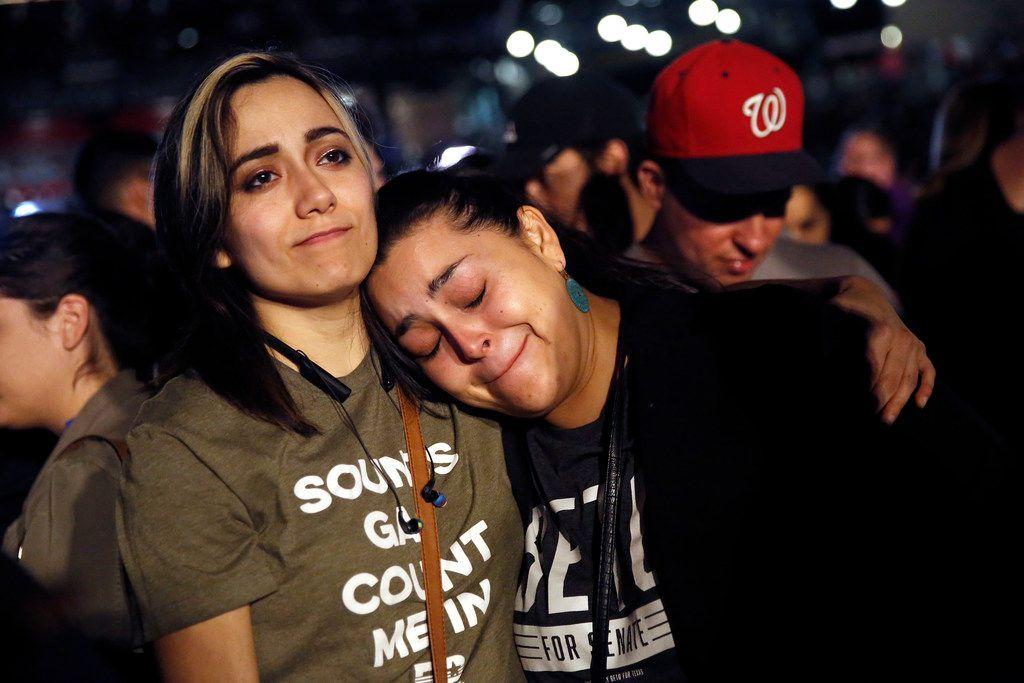 Rio Salazar (left) comforts her friend and Beto O'Rourke volunteer Rebecca Guerreo of El Paso at the El Paso Democrat's Election Night party in El Paso on Nov. 6, 2018.