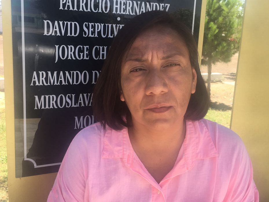 Luz del Carmen Sosa, a founder of the Red de Periodistas de Juarez network that fights for journalists rights, stands in front of a plaque with names of journalist who have died including those who were murdered.