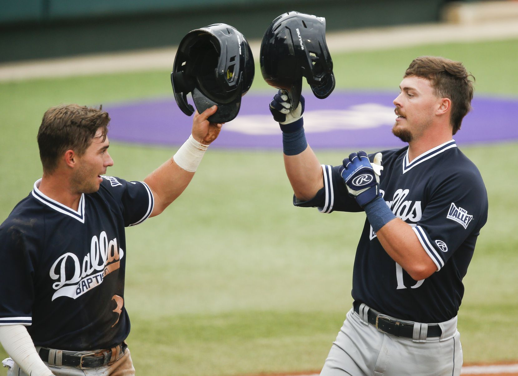 DBU Cole Moore, right, is congratulated by Jackson Glenn (3) after hitting a two-run home run in the first inning during the NCAA Fort Worth Regional baseball tournament against Oregon State at TCU's Lupton Stadium in Fort Worth, Friday, June 4, 2021. Dallas Baptist won 6-5. (Brandon Wade/Special Contributor)