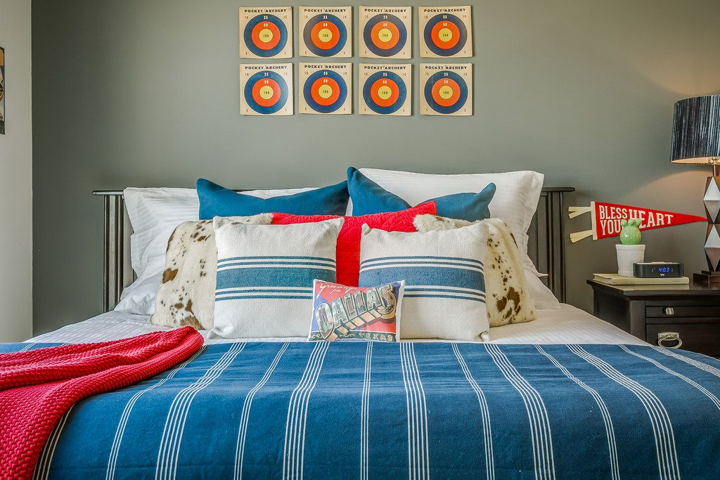 It's all fun and games at the State Fair-themed apartment available for visitors to Dallas on Airbnb. The designer used vintage targets from an archery game to create focal interest in the master bedroom.