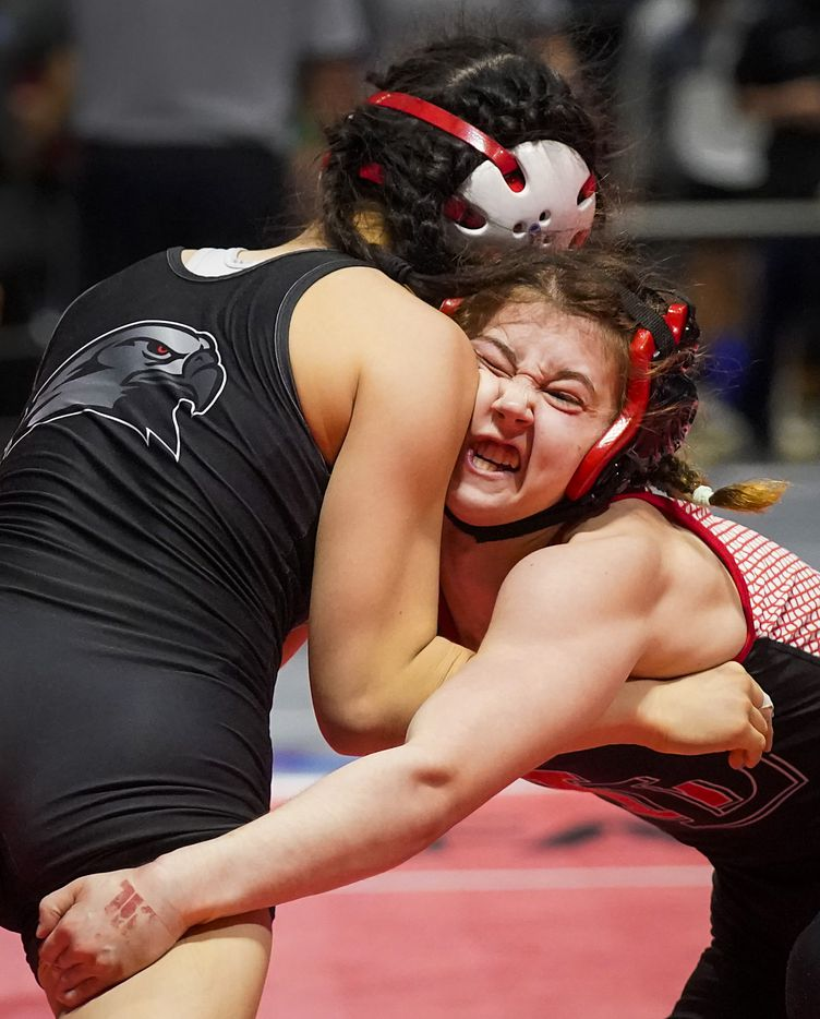 Avery Ashley of Lucas Lovejoy (facing) wrestles Stephanie Qin of Frisco Liberty in the 5A girls 110-pound third place match during the UIL State Wrestling tournament at the Berry Center on Friday, April 23, 2021, in Cypress, Texas.