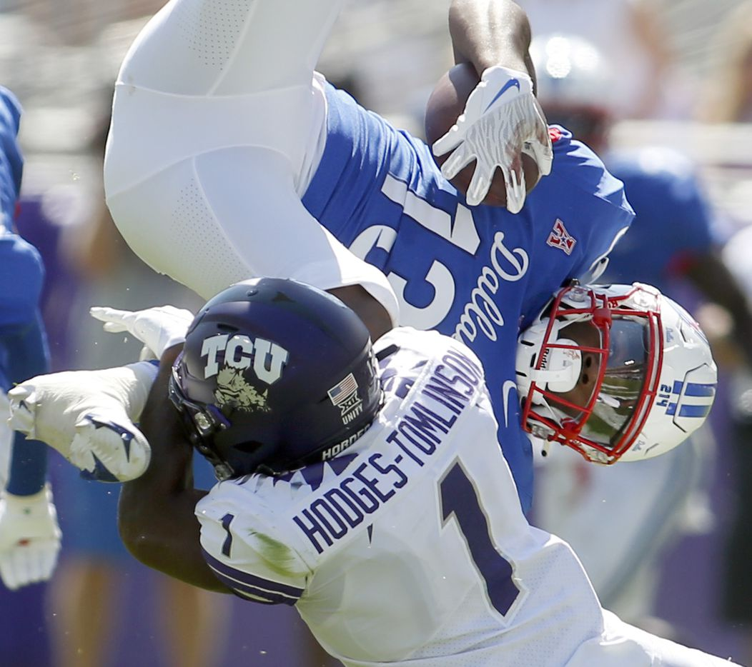 SMU receiver Roderick Daniels, Jr. (13) is upended by TCU cornerback Tri'Vius Hodges-Tomlinson (1) after a short gain from 2nd quarter reception. The two teams played their NCAA football game at Amon G. Carter Stadium on the campus of TCU in Fort Worth on September 25, 2021. (Steve Hamm/ Special Contributor)